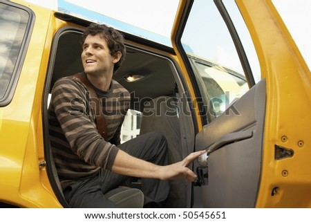 Man exiting taxi in street, low angle view #50545651