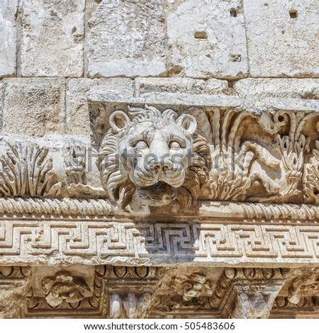 Lion head carved on a marble block in Baalbek #505483606
