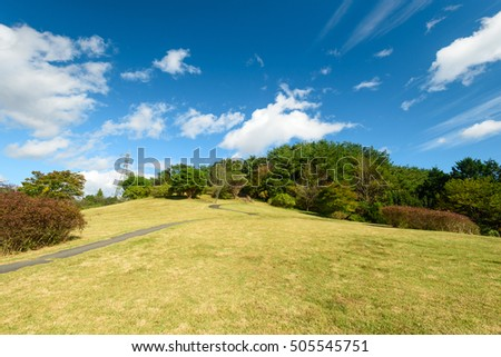 Beautiful landscape of public garden, mountain and forest with cloudy blue sky background #505545751