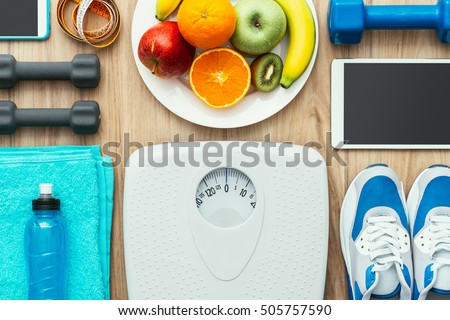 Sports and workout equipment, digital tablet and fruit on a wooden table, training and healthy lifestyle concept, flat lay #505757590