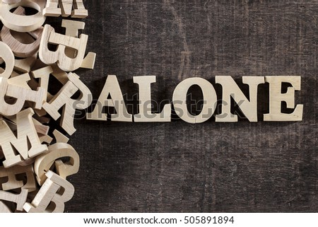 ALONE word made with wooden letters #505891894