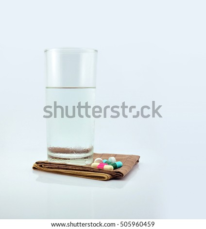Glass of water and pills  on white background #505960459