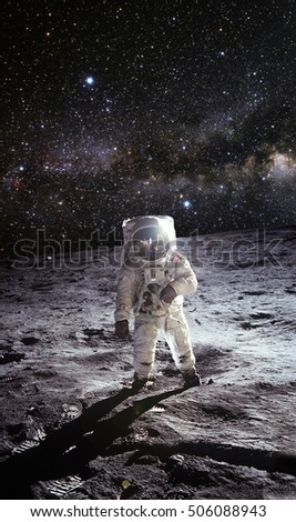 Astronaut on lunar (moon) with shadow. Elements of this image furnished by NASA. #506088943