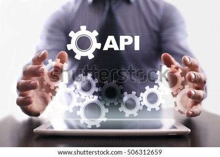 Businessman is using tablet pc and selecting api
