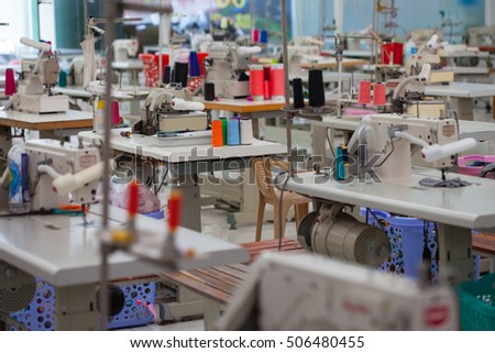 garment factory with no people and many tailoring tools Royalty-Free Stock Photo #506480455