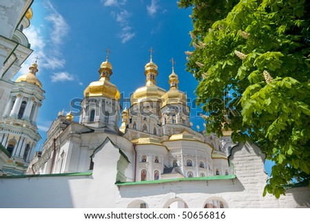 The domes of Peshtersk Lavra - a shot from behind the wall #50656816