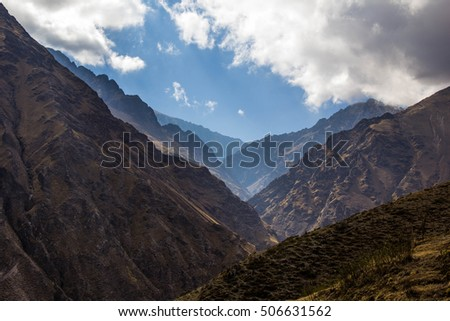 View of Iruya village and multicolored mountains in the surroundings at sunset, Salta province, Argentina, San Isidro - San Juan treeking #506631562