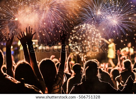 New Year concept - cheering crowd and fireworks #506751328