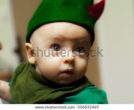 Baby with soft skin, focusing on something