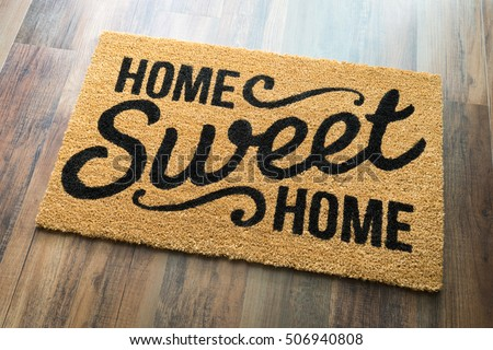 Home Sweet Home Welcome Mat On Wood Floor. #506940808