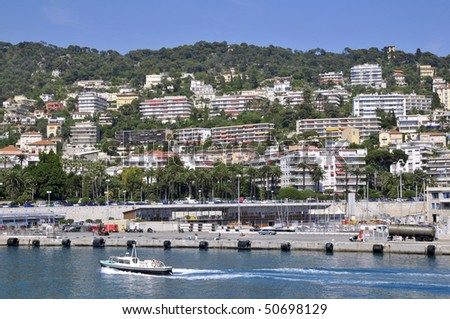Port of Nice in southeastern France,department Alpes-maritimes, with many buildings on the mountain #50698129