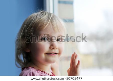 Beautiful  little girl is by window portrait #50705497