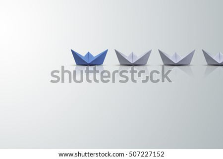 uniqueness concept, paper boat outstanding from the others  #507227152