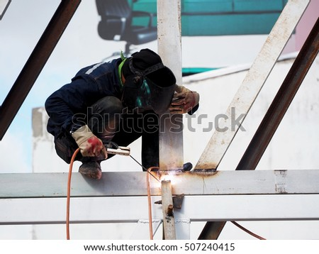 Welding work,worker with protective welding metal on construction #507240415