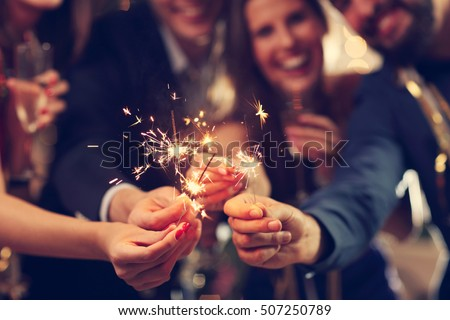 Picture showing group of friends having fun with sparklers Royalty-Free Stock Photo #507250789