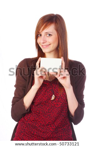 Smiling girl holding an empty business card, isolated on white #50733121