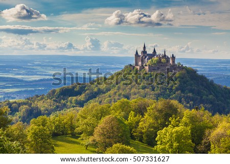 Aerial view of famous Hohenzollern Castle, ancestral seat of the imperial House of Hohenzollern and one of Europe's most visited castles, in beautiful golden evening light, Baden-Wurttemberg, Germany #507331627