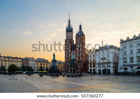 Main market square of Cracow in soft light of sunrise, vie of St. Mary cathedral. Krakow, Rynek Glowny, Bazylika Mariacka #507360277