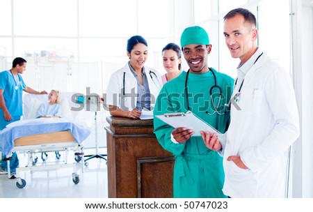 Portrait of a serious medical team at work in hospital #50747023