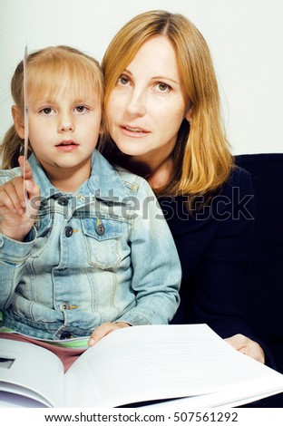 mother with daughter together in bed smiling, happy family close up, lifestyle people concept, cool real modern family #507561292