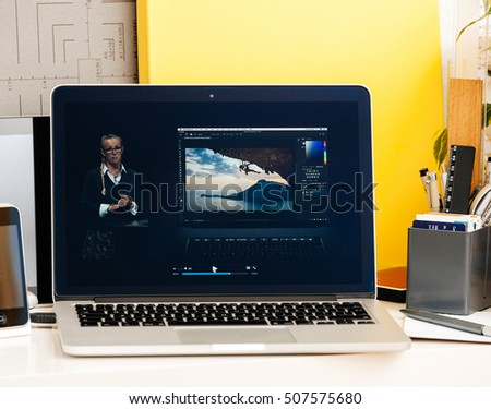 PARIS, FRANCE - OCT 28 2016: Apple Computers website on new MacBook Pro Retina with OLED Touch bar in  room showcasing Apple Keynote presentation of Bradee Evans from Adobe OLED Photoshop inegration #507575680