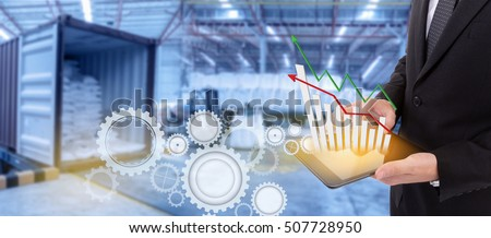Business hand holding growth chart of transport business on tablet with supply chain management ,Logistic Import Export   background  #507728950