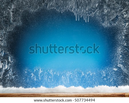 Wooden sill and frozen window. Christmas or New Year background. Royalty-Free Stock Photo #507734494