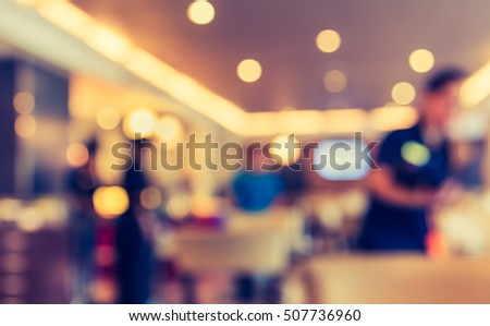 image of blur restaurant or coffee shop on day time with bokeh for background usage . (vintage tone) #507736960