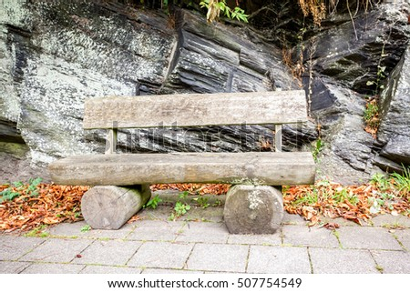 an old wooden bench in the street #507754549