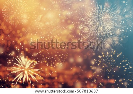 Fireworks at New Year and copy space - abstract holiday background Royalty-Free Stock Photo #507810637