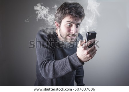 Angry man shouting at his cell phone, enraged with the bad service, burning with rage Royalty-Free Stock Photo #507837886