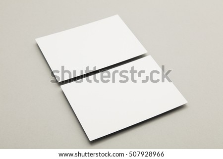 Blank white business card postcard flyer on a grey background Royalty-Free Stock Photo #507928966