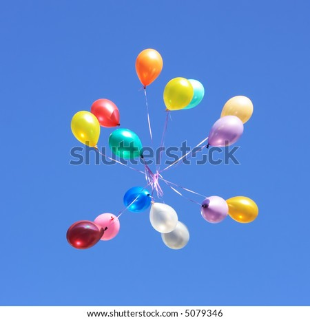Flying balloon after celebration in the clear blue sky #5079346
