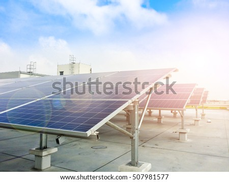 Soft focus of Solar panels or Solar cells on factory rooftop or terrace with sun light, Industry in Thailand, Asia. Can saving energy. Sun or renewable or Clean energy. #507981577