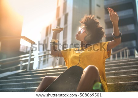 Cool skater girl dancing in the street #508069501