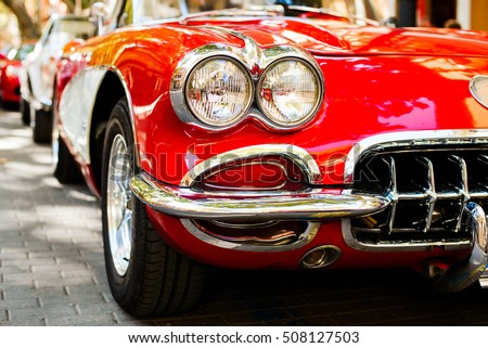 Close-up of headlights of red vintage car. Exhibition Royalty-Free Stock Photo #508127503