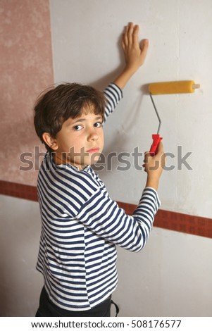 preteen boy help wallpapering, boy stick wallpaper close up portrait #508176577