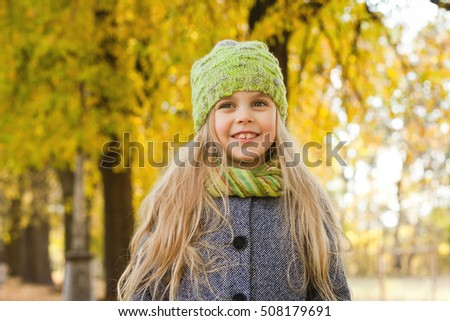 little girl in park in autumn, space for text #508179691