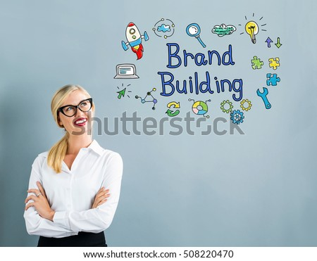 Brand Building text with business woman on a gray background #508220470