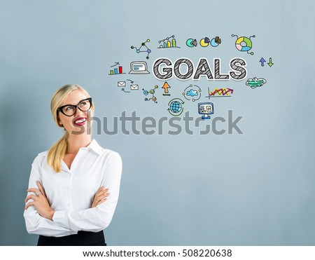 Goals text with business woman on a gray background #508220638