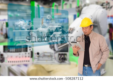 Industry 4.0 and Smart manufacturing concept. Engineer using digital tablet to monitor manufacturing process in the factory with futuristic icons on virtual panel. #508287112