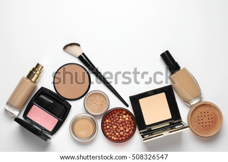 Make-up cosmetics set of liquid and cream foundations, compact and loose powder in various tones, bronzing pearls, blush and brush on white background. Top view point. #508326547