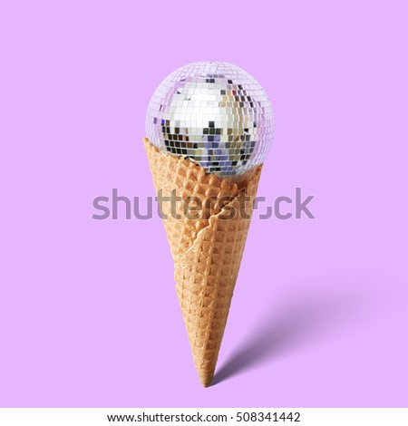 Waffle cornet with disco ball isolated on purple Royalty-Free Stock Photo #508341442