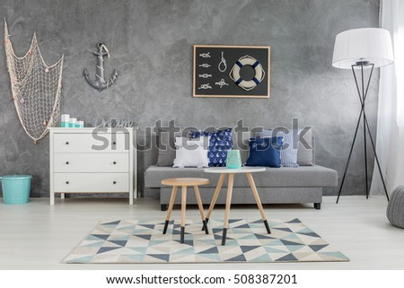 Modern grey living room with nautical decorations and decorative wall finish #508387201