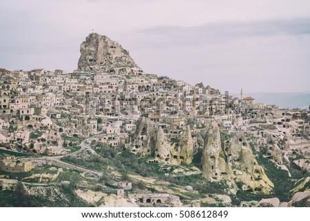Uchisar castle in Cappadocia, Turkey. Toned like Instagram filter #508612849