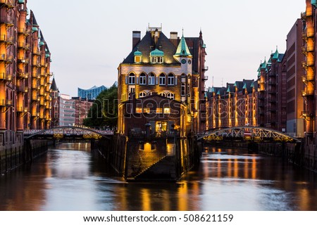 HAMBURG, GERMANY - JUNE 6, 2016: Typical view of the Speicherstadt, also called Hafen City,  in Hamburg on June 6, 2016. Its a popular harbour quarter for tourists in Hamburg. #508621159