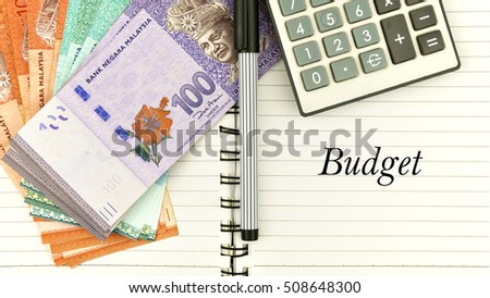 "conceptual image with cash, calculator and notepad with word "" b #508648300"