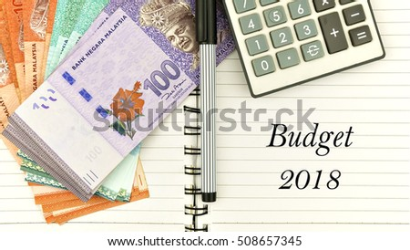"conceptual image with cash, calculator and notepad with word "" budget 2018"" #508657345"