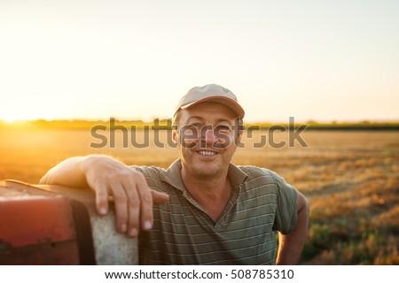 Middle aged man portrait on farmland.  Royalty-Free Stock Photo #508785310