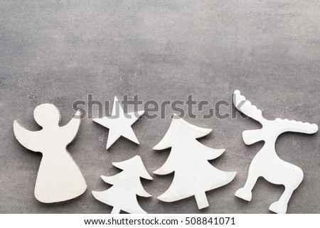 Christmas background. White tree decorations on a gray background. Deer. Spruce. Star. Angel. #508841071